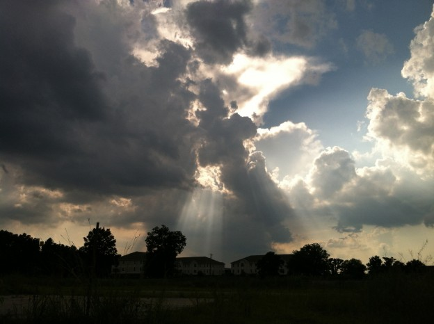 Light shines brightly behind the clouds.